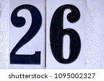 number 26  twenty six  on old... | Shutterstock . vector #1095002327