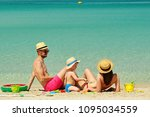 family on beach. two year old... | Shutterstock . vector #1095034559