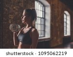 athletic young girl with...   Shutterstock . vector #1095062219