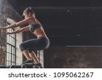 jumping sports woman in the loft | Shutterstock . vector #1095062267