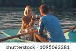 young couple in a boat in summer | Shutterstock . vector #1095063281