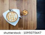 freshly coffee macchiato with... | Shutterstock . vector #1095075647