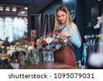 young florist with bouquet at... | Shutterstock . vector #1095079031