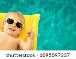 funny baby boy on summer... | Shutterstock . vector #1095097337