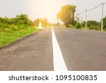 rural road with trees and... | Shutterstock . vector #1095100835