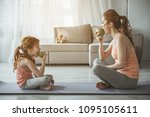 profile of woman and kid after... | Shutterstock . vector #1095105611