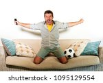 young enthusiastic football fan ... | Shutterstock . vector #1095129554