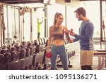 fitness instructor helping girl ... | Shutterstock . vector #1095136271