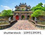 Small photo of Scenic view of the East Gate (Hien Nhon Gate) to the Citadel with the Imperial City on summer sunny day in Hue, Vietnam. The colorful gate is a popular tourist attraction of Hue.