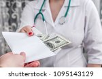 Bribery  Hands Of Doctor With...