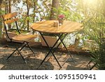 summer cafe. wooden round table ... | Shutterstock . vector #1095150941