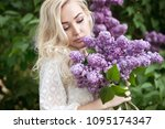 beautiful woman with lilac... | Shutterstock . vector #1095174347