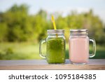 glass of detox smoothie on... | Shutterstock . vector #1095184385