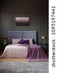 violet blanket on bed with... | Shutterstock . vector #1095197441