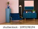Navy blue armchair in modern...