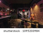 Stock photo modern jazz bar interior design stage with black piano and cello lamps above bar counter 1095203984
