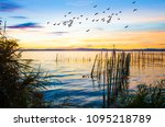 colorful sunset on the lake | Shutterstock . vector #1095218789