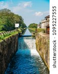 Small photo of Cascade on a lock at the Naviglio Pavese, a canal that connects the city of Milan with Pavia, Italy