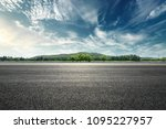 asphalt road and mountain with... | Shutterstock . vector #1095227957