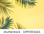 tropical palm leaves on yellow... | Shutterstock . vector #1095301661