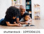african american father reading ... | Shutterstock . vector #1095306131