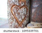 Heart Carved On A Wooden Log.