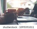 business man holding mug of hot ... | Shutterstock . vector #1095351011