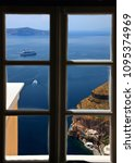 Small photo of SANTORINI ISLAND, CYCLADES, AEGEAN SEA, GREECE- May 6, 2010. A view of the caldera through a window in Fira village.