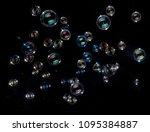 Rainbow Soap Bubbles On Black...