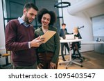 coworkers standing in an office ... | Shutterstock . vector #1095403547