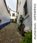 streets of obidos. portugal.... | Shutterstock . vector #1095409421