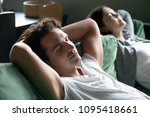 young guy relaxing on... | Shutterstock . vector #1095418661