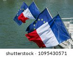 European Union Flag and French Flag on Seine river