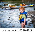 Happy Kid Kayaking On The River....