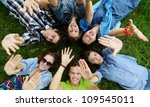 group of friends lying on meadow | Shutterstock . vector #109545011