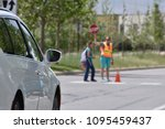 a school crossing guard walks a ... | Shutterstock . vector #1095459437