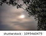 sun hiding behind the hazed sky | Shutterstock . vector #1095460475
