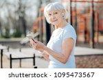 music fan. joyful fit woman...   Shutterstock . vector #1095473567