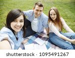 group of friends taking a... | Shutterstock . vector #1095491267