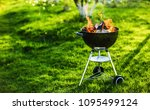 barbecue grill with fire on... | Shutterstock . vector #1095499124