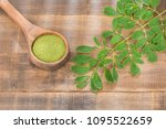 moringa powder and leaves. top... | Shutterstock . vector #1095522659