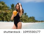 young woman in black swimsuit... | Shutterstock . vector #1095530177