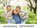 three sister girls playing on... | Shutterstock . vector #1095543569