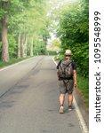man with backpacks walks alone... | Shutterstock . vector #1095548999