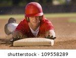 Young Baseball Player Sliding...