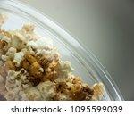 popcorn in bowl. | Shutterstock . vector #1095599039