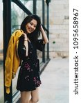 smiling tourist girl in cute...   Shutterstock . vector #1095658967