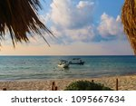 fishing boats in a tropical sea. | Shutterstock . vector #1095667634