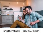 couple looking at mobile phone... | Shutterstock . vector #1095671834