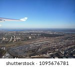 Small photo of Montreal, Quebec / Canada - May 13 2017: aerial view of Montreal city. Featuring train station, car park, low and high-rise buildings, blue water of St Lawrence river. Dorval, La Chine, Cote Saint-Luc